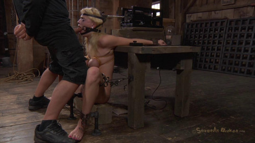 BDSM Allie James is locked into a automatic blow job machine, with huge ring gag!