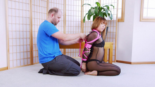 BDSM Hogtied position with belts