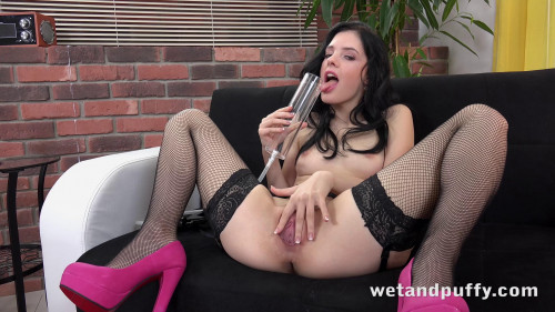 Fisting and Dildo A pretty brunette fills herself with pleasure