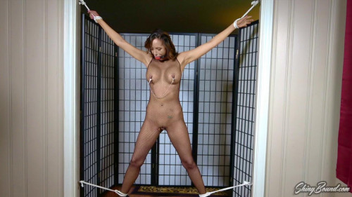 BDSM Lucy is frogtied in a squatting position