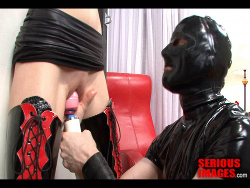 bdsm Rubber Couple Chained To The Wall