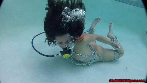 BDSM Extreme bondage and hogtie for naked model in the swimming pool