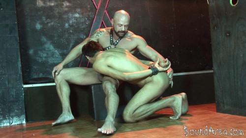 Gay BDSM Bound Area - Tough SM stud handles his nude cuffed twink-sub