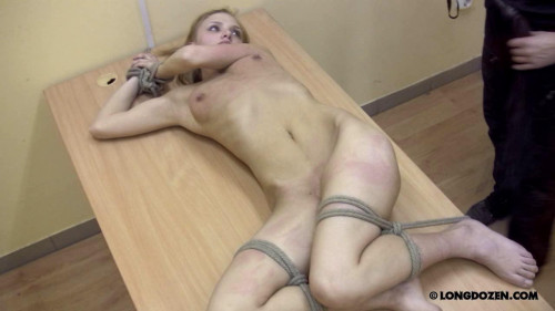 BDSM pain on table