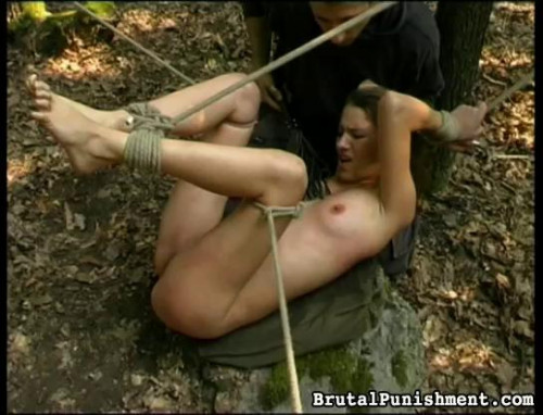 With rope tight around a leg and her wrists, shes silenced with tape
