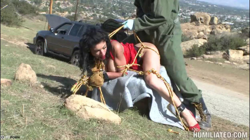 Pervert mocks a chick in the desert BDSM Latex