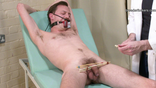Joe - Tied to a medical exam table