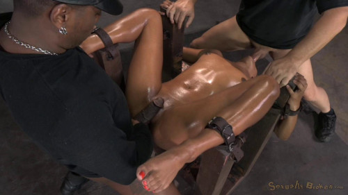 Redheaded slut Daisy Ducati bound down and fucked hard by 2 big cocks BDSM