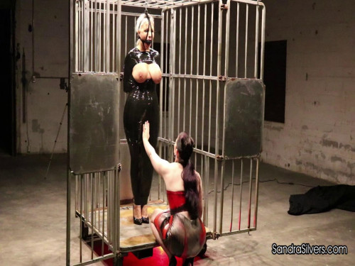 Sandra Silvers & Caroline Pierce - Rubber Mistress Gets Delivery of Caged