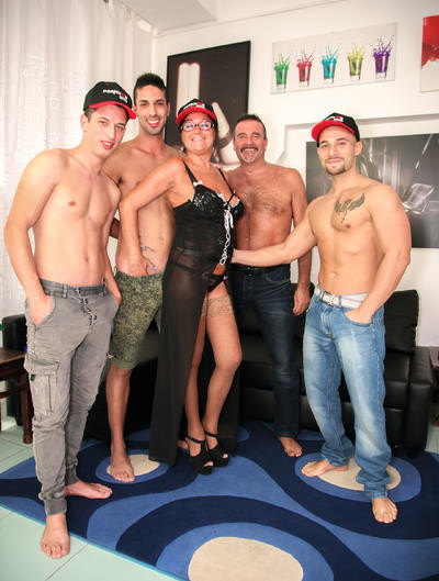 Italian orgy features brunette mature amateur fucked by four young cocks