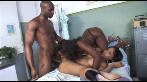 Two ebony sluts share a hard black dick