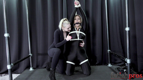 Red August Bondage Orgasms in Black Catsuit