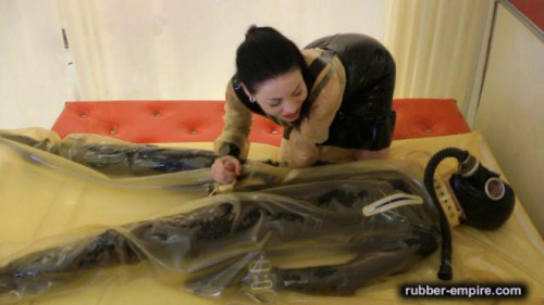 The Rubber Bed Femdom and Strapon
