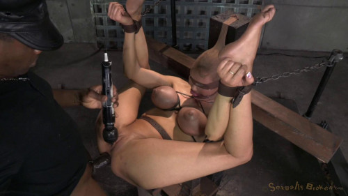 Huge beasted Rain DeGrey restrained in strict tying