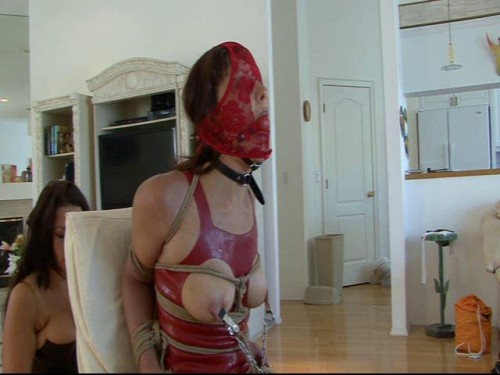 Then the ties a rope around her neck and pulls her head down to her knees