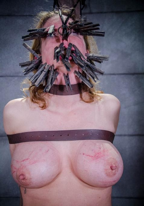 Face torture with clothespins