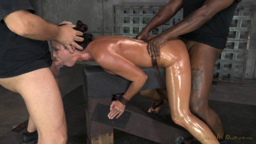 India Summer shackled down and used hard by two cocks