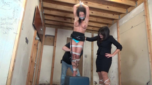 Muscular woman hung like a side of beef