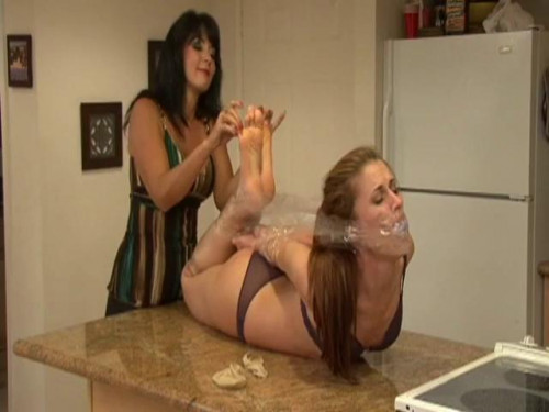 Helplessly Bound And Foot Tickled