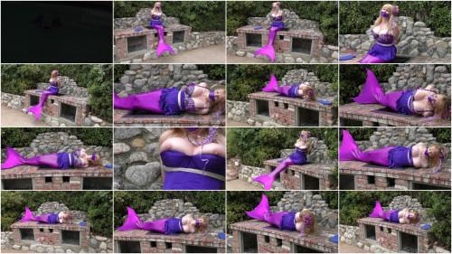 Captured Mermaid Lorelei Bound on the Grill