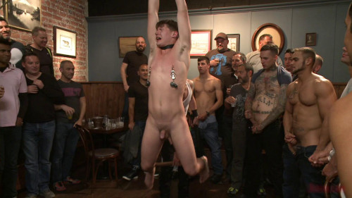 Bound whore gang fucked in a packed bar