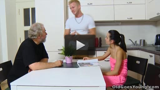 Lora and her man are in the kitchen talking and he talks about inviting his older friend over.