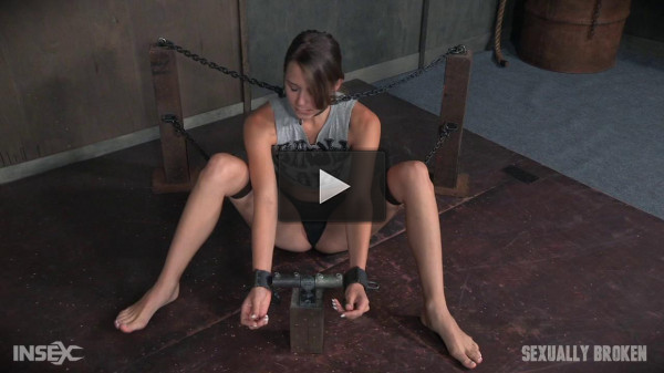 Zoey Laine is chained and shackled down.