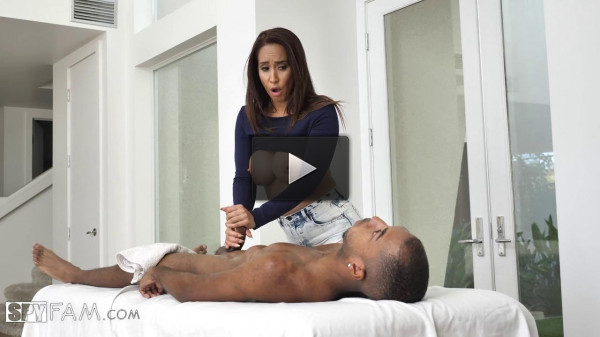Busty wench makes a massage to a young Negro