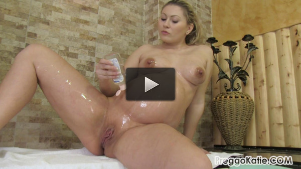 Katie — Oiled Up Pregnant Belly